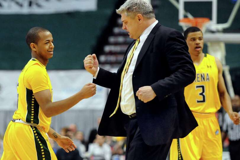 Siena's Evan Hymes, left, celebrates with coach Jimmy Patsos on a timeout during their basketball ga