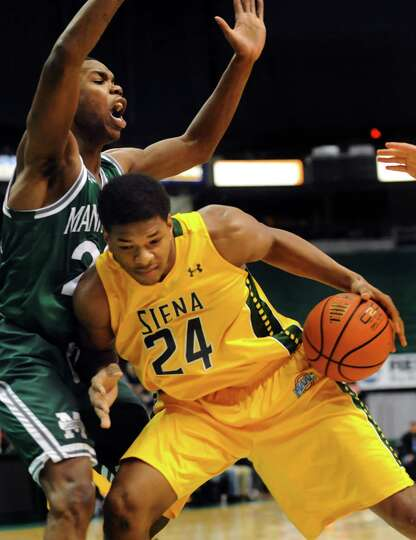 Siena's Lavon Long, right, bumps for room as Manhattan's Rich Williams defends during their basketba