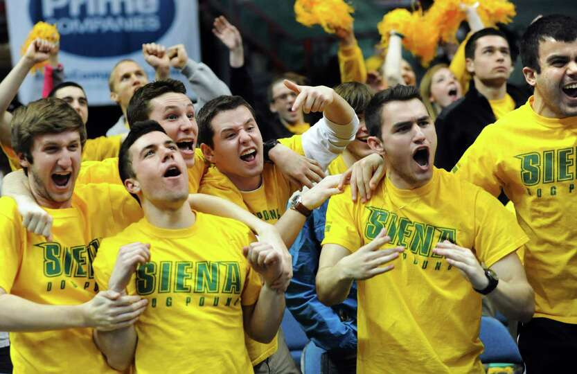 Siena's student section cheers when their image is on the jumbotron during their basketball game aga