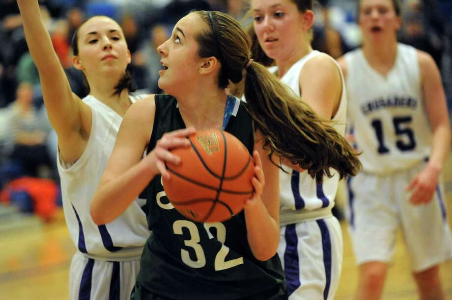 Shenendehowa's Carly Boland, center, looks to the hoop during their quarterfinal basketball game against CCHS on Friday, Feb. 21, 2014, at Shaker High in Latham, N.Y. (Cindy Schultz / Times Union) Photo: Cindy Schultz / 00025829A