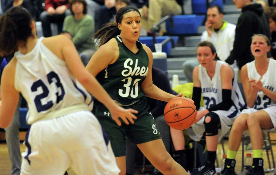Shenendehowa's Samira Sangare, right, controls the ball during their quarterfinal basketball game against CCHS on Friday, Feb. 21, 2014, at Shaker High in Latham, N.Y. (Cindy Schultz / Times Union) Photo: Cindy Schultz / 00025829A