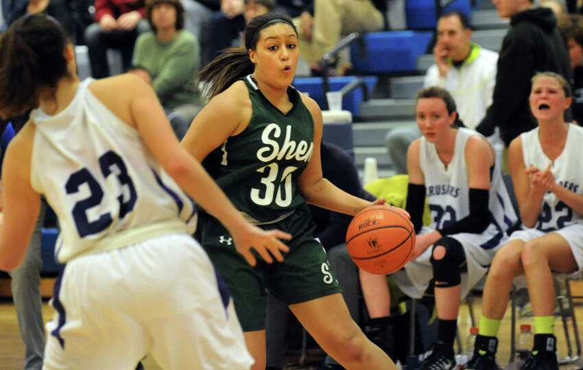 Shenendehowa's Samira Sangare, right, controls the ball during their quarterfinal basketball game ag