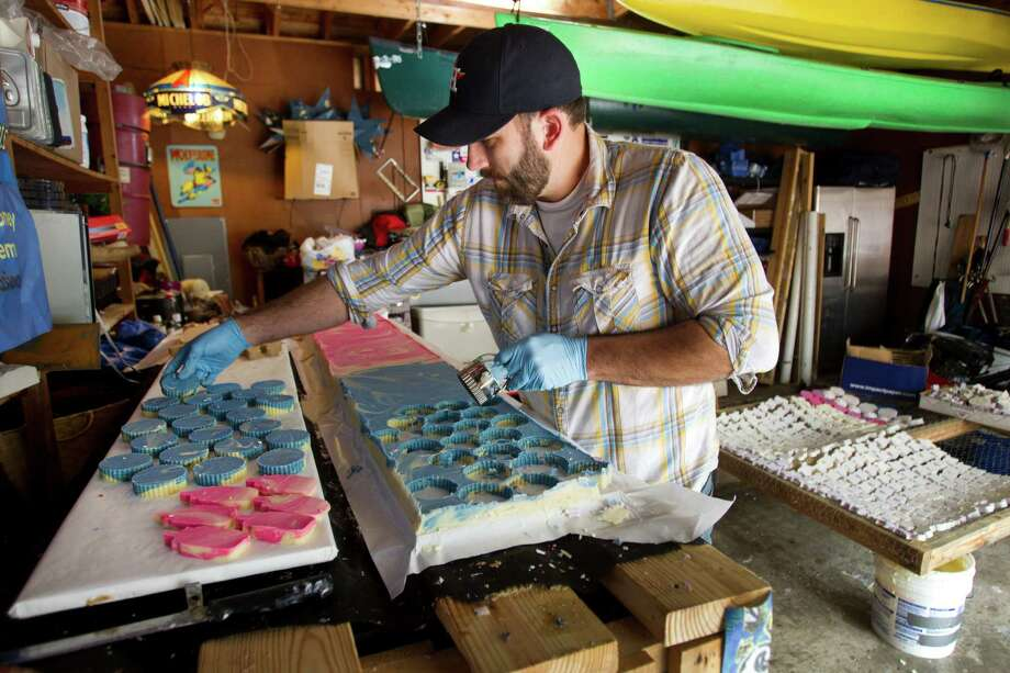 Mark Renn, here cutting out beeswax soap, started his sideline in Alabama and expanded it after moving to Texas last year. Photo: Brett Coomer, Staff / © 2014 Houston Chronicle