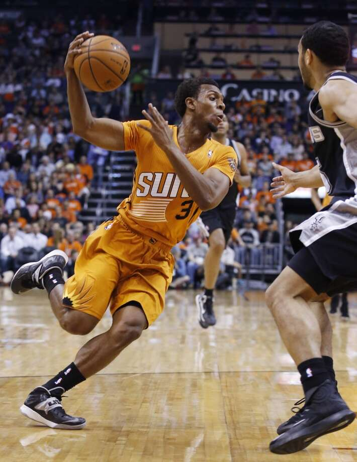 Phoenix Suns' Ish Smith (3) drives past San Antonio Spurs' Cory Joseph, right, during the first half of an NBA basketball game, Friday, Feb. 21, 2014, in Phoenix. (AP Photo/Ross D. Franklin) Photo: Associated Press
