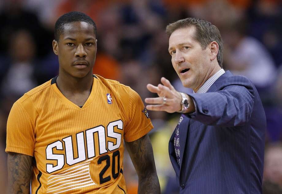 Phoenix Suns head coach Jeff Hornacek, right, talks with Archie Goodwin (20) during the second half of an NBA basketball game against the San Antonio Spurs, Friday, Feb. 21, 2014, in Phoenix.  The Suns defeated the Spurs 106-85. (AP Photo/Ross D. Franklin) Photo: Associated Press