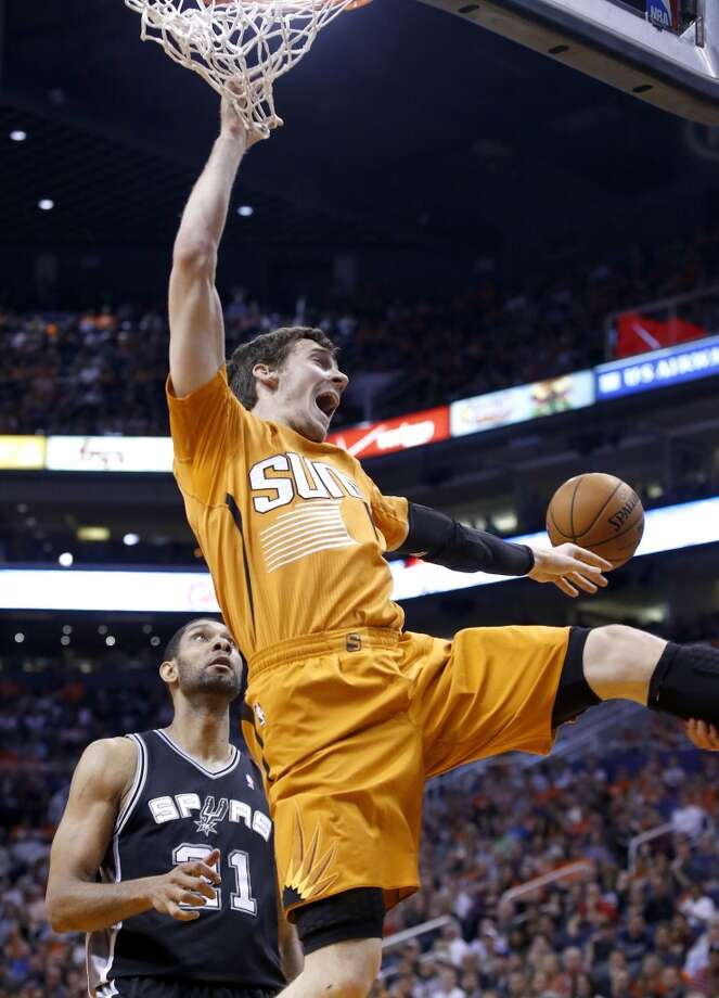 Phoenix Suns' Goran Dragic, right, of Slovenia, loses the ball as San Antonio Spurs' Tim Duncan, left, watches during the first half of an NBA basketball game, Friday, Feb. 21, 2014, in Phoenix. Dragic was called for an offensive foul on the play. (AP Photo/Ross D. Franklin) Photo: Associated Press