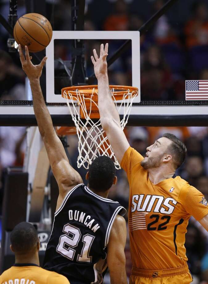 San Antonio Spurs' Tim Duncan (21) gets off a shot over Phoenix Suns' Miles Plumlee (22) during the first half of an NBA basketball game, Friday, Feb. 21, 2014, in Phoenix. (AP Photo/Ross D. Franklin) Photo: Associated Press