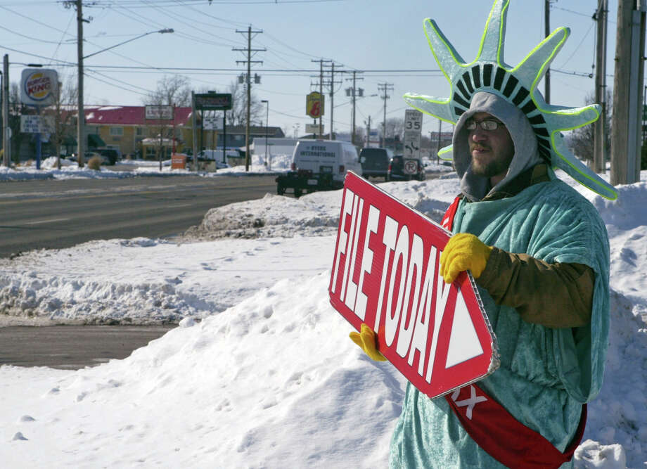Eddie Six of Jacksonville, Ill., paces outside an income tax service. There are a few tweaks in federal laws this year that could affect some taxpayers. Photo: Bre Linstromberg Copper, MBR / Jacksonville Journal-Courier