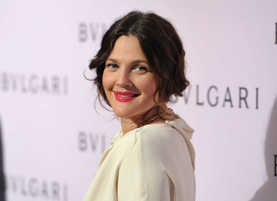 FILE - In this Feb. 19, 2013 file photo, Drew Barrymore arrives at BVLGARI's event celebrating Elizabeth Taylor and her magnificent BVLGARI jewel collection at BVLGARI Beverly Hills, in Beverly Hills, Calif. Fancy having Brad Pitt and Angelina Jolie, Barrymore and Dan Aykroyd over for dinner? You might start with an aperitif of Jolie and Pitt's new Miraval rose, move on to a light pasta dish served with Barrymore Wine's pinot grigio, then perhaps finish up with a glass of Canadian Aykroyd's cabernet franc ice wine for dessert. (Photo by John Shearer/Invision/AP, File) Photo: John Shearer / Invision