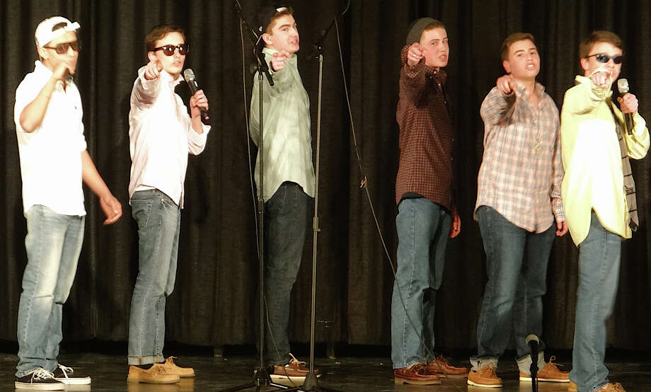 The Overtones, from Fairfield Warde High School, perform Friday night at A Cappella Night hosted by Tomlinson Middle School. Photo: Mike Lauterborn / Fairfield Citizen contributed