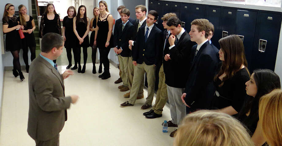 Fairfield Ludlowe High School's Close Harmony group, under direction of Kevin Cotellese, rehearses for the performance at A Cappella Night at Tomlinson Middle School. Photo: Mike Lauterborn / Fairfield Citizen contributed