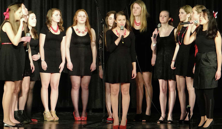 Fairfield Warde High School's all-girl Muse vocal group performs Friday at Tomlinson Middle School. Photo: Mike Lauterborn / Fairfield Citizen contributed