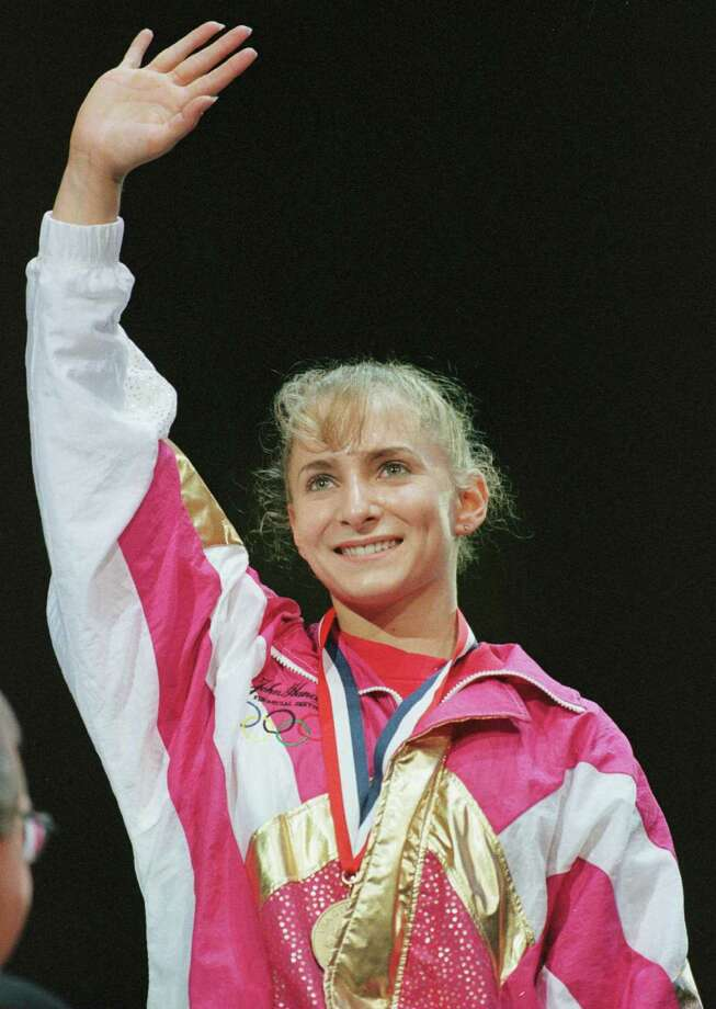 7 Jun 1996:  Shannon Miller waves from the podium after receiving the gold medal in the All-Around competition at the USA Gymnastics National Championships at the Thompson-Boling Arena, on the campus of the University of Tennessee in Knoxville. Mandatory Photo: Doug Pensinger, Getty Images / Getty Images