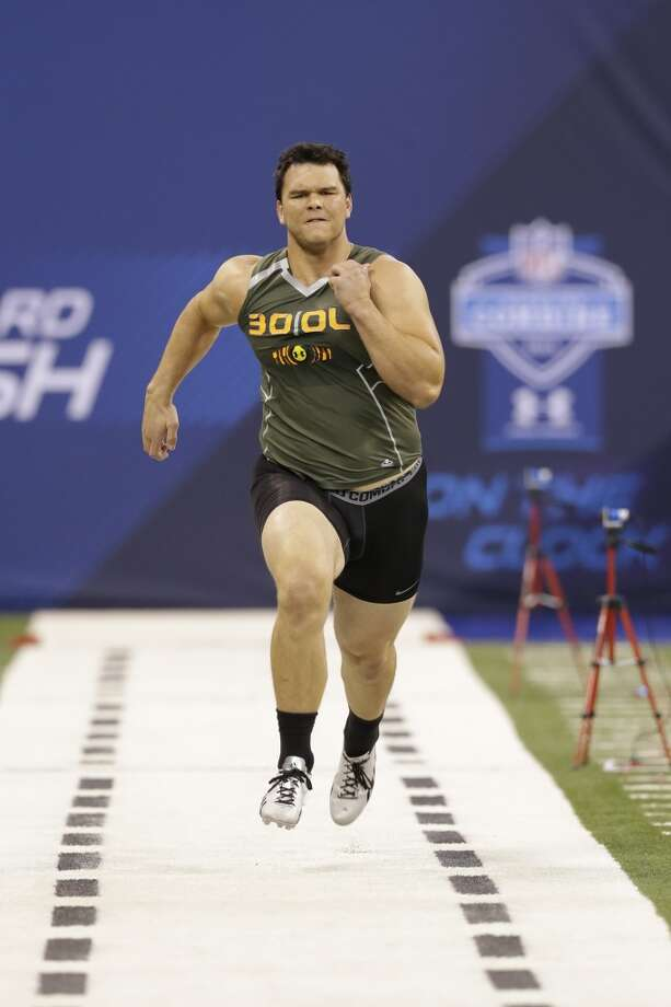 Former Texas A&M offensive lineman Jake Matthews runs the 40-yard dash at the NFL combine. Photo: Nam Y. Huh, Associated Press