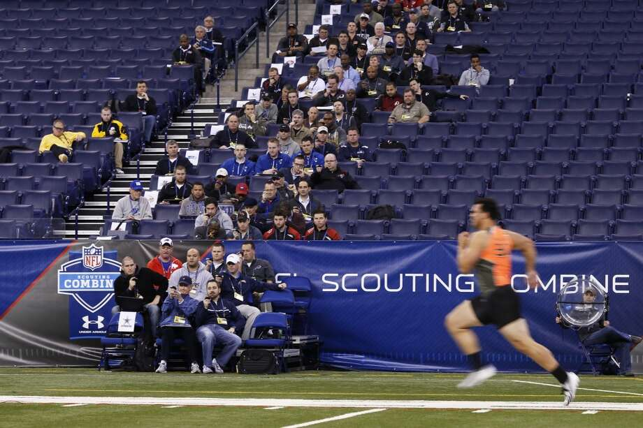 Former Texas A&M offensive lineman Jake Matthews runs the 40-yard dash at the NFL combine. Photo: Joe Robbins, Getty Images