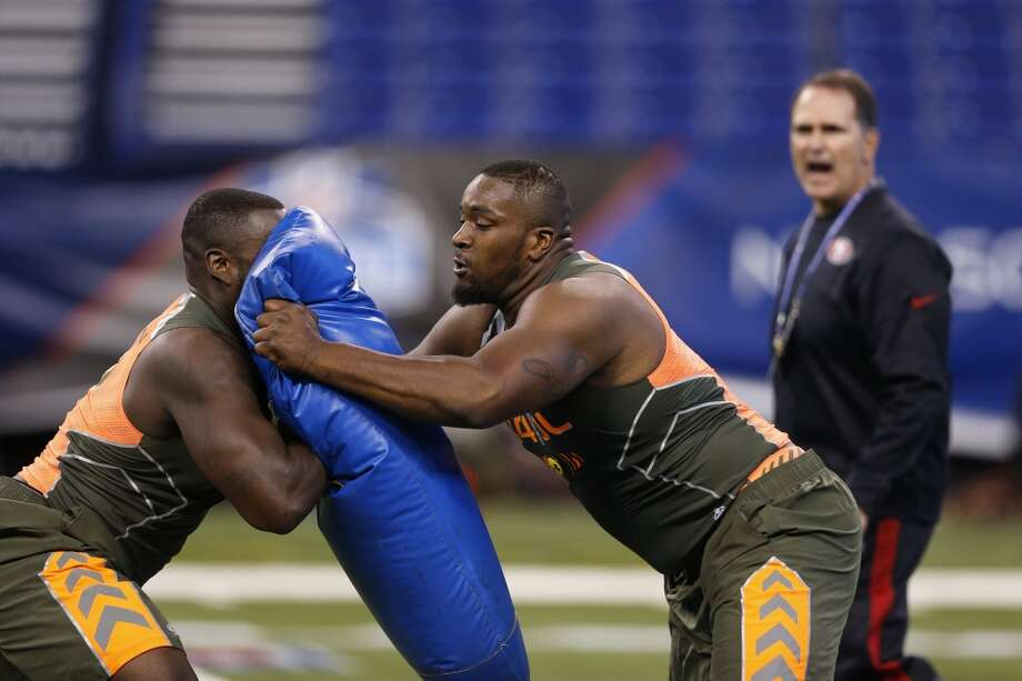 Former Miami offensive lineman Seantrel Henderson (right) runs a blocking drill with former Florida offensive lineman Jonotthan Harrison Photo: Joe Robbins, Getty Images
