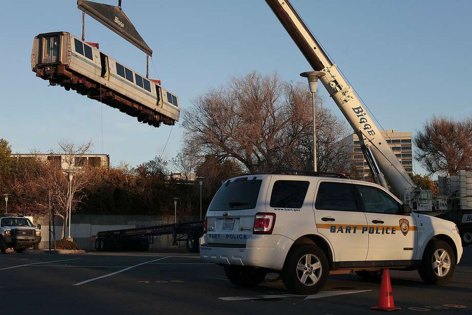 A Bart cart is lifted from the tracks near the Concord Bart station in Concord, Calif. on Saturday, Feb. 22, 2014. A train derailed near the Concord Bart Station late Friday night. Photo: James Tensuan, Special To The Chronicle