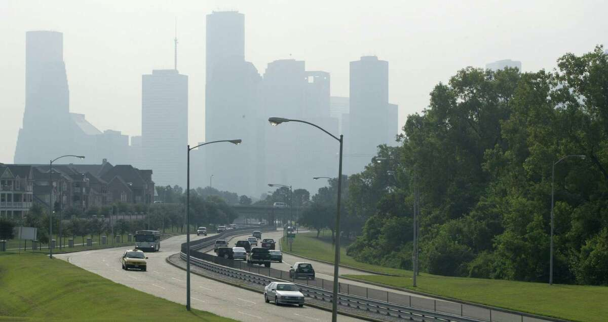 Smog shrouds downtown Houston while morning traffic traverses Memorial Drive. (Buster Dean / Chronicle)