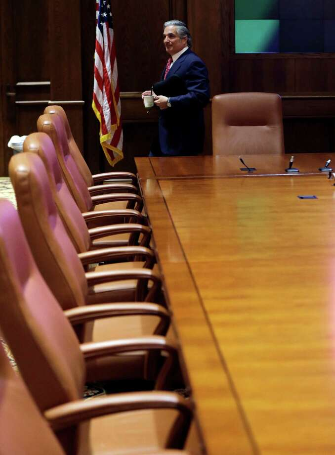 University of Texas System Chancellor Francisco Cigarroa leaves the board of regents room after a news conference where he announced his resignation Monday, Feb. 10, 2014, in Austin, Texas. Cigarroa, who has held the position for five years, will continue to serve as chancellor until his successor is named. (AP Photo/Eric Gay) Photo: Eric Gay, STF / AP