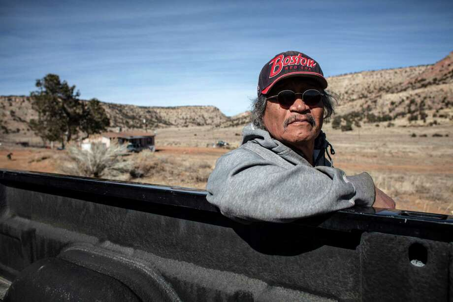 """Tony Hood, near his home in the Red Water Pond Road area of the Navajo reservation in New Mexico, says residents will eventually return because: """"This is our connection to Mother Earth."""" Photo: MARK HOLM, STR / NYTNS"""