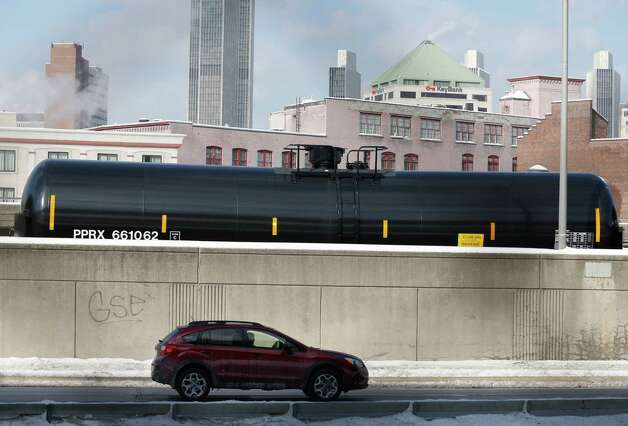A railroad oil tanker car is parked along Interstate 787 in downtown Albany, N.Y., on Friday, Feb. 7, 2014. The Port of Albany has become a hub for the U.S. oil business, taking shipments from North Dakota's Bakken Shale daily by mile-long trains and shipping it in tankers down the Hudson River to refineries. Opponents of a proposal to build boilers to liquefy heavy crude passing through Albany by rail are drawing attention to the capital's emergence as a major hub for the transport of oil that's widely considered risky from an environmental and safety standpoint. (AP Photo/Mike Groll) ORG XMIT: NYMG207