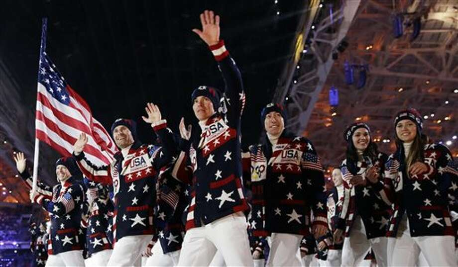 The team from the U.S. enters the stadium for the  opening ceremony of the Sochi Winter Olympic games. / THE ASSOCIATED PRESS2014