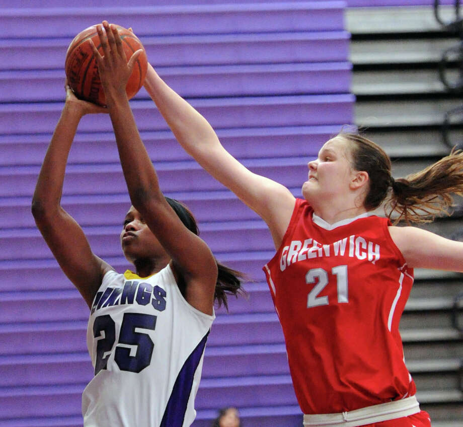 At right, Abigail Wolf (# 21) of Greenwich blocks the layup attempt of Westhill's Krystal Dixon (#25) during the FCIAC girls basketball quarterfinal between Westhill High School and Greenwich High School at Westhill in Stamford, Saturday, Feb. 22, 2014. Greenwich defeated Westhill, 55-51. Photo: Bob Luckey / Greenwich Time