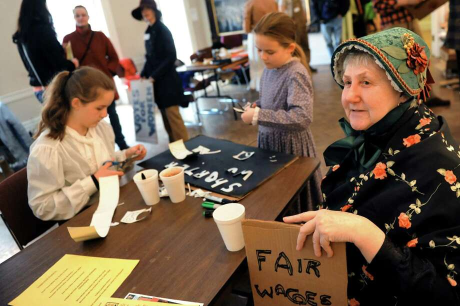 Rosemary Nichols of Watervliet, chair of the Capital District Civil War Round Table, right, prepares to walk to the Troy Farmers Market on Saturday, Feb. 22, 2014, at Rensselaer County Historical Society in Troy, N.Y.The walk commemorated the 150th anniversary of Kate Mullany's historic formation of the Collar Laundry Union in Troy. Mullany organized 300 of her fellow laundry workers to strike for higher wages and improved working conditions in the collar laundries. (Cindy Schultz / Times Union) Photo: Cindy Schultz / 00025852A