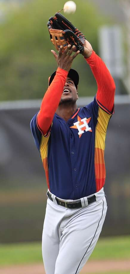 Astros outfielder L.J. Hoes makes a catch during a spring training workout. Photo: Karen Warren, Houston Chronicle