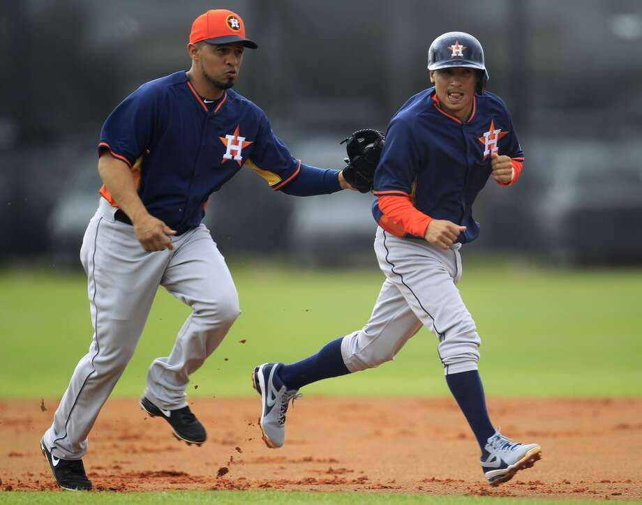 Cesar Izturis of the Astros chases Ronald Torreyes in a rundown drill during spring training workouts. Photo: Karen Warren, Houston Chronicle