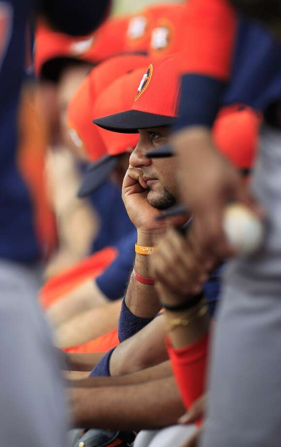 Astros catcher Carlos Corporan sits with teammates in the dugout during a spring training workout. Photo: Karen Warren, Houston Chronicle