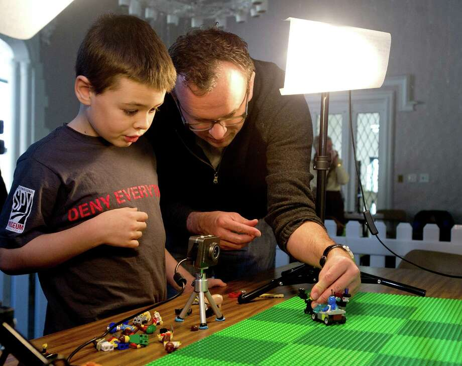 Calvin Donat, 7, and his father, Sam, make a stop-motion video during the LEGO Animation Workshop at the Stamford Museum and Nature Center on Saturday, February 22, 2014. Photo: Lindsay Perry / Stamford Advocate