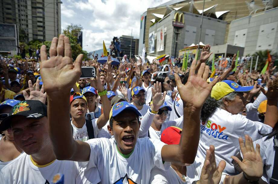 A huge protest in Caracas against Venezuelan President Nicolas Maduro is the largest rally so far after a violent week that left 10 dead and at least 100 hurt. Photo: Juan Barreto, AFP/Getty Images