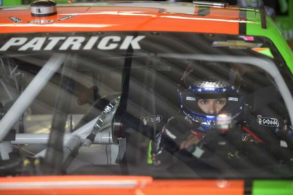 Danica Patrick in her car at a practice session for the Daytona 500 NASCAR Sprint Cup Series auto race at Daytona International Speedway in Daytona Beach, Fla., Friday, Feb. 21, 2014. (AP Photo/Phelan M. Ebenhack)