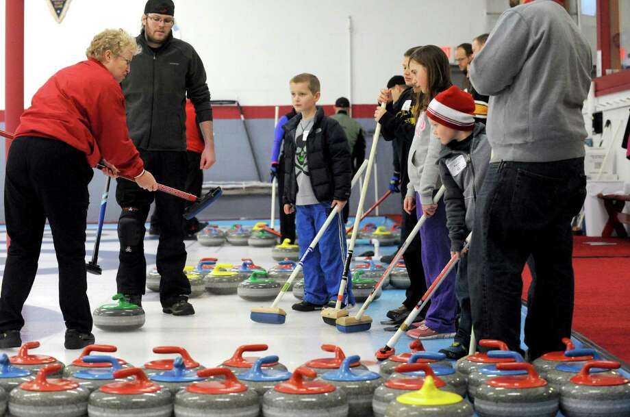 Eileen Kelliher, left, gives and introduction to the sport of curling during the Schenectady Curling Club open house on Saturday Feb. 22, 2014 in Niskayuna, N.Y. (Michael P. Farrell/Times Union) Photo: Michael P. Farrell / 00025850A
