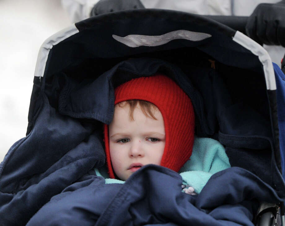 Andrew Mahoney, 3, of Greenwich, is all bundled-up as he gets a ride in a stroller being pushed by his grandmother, Jane Mahoney, also of Greenwich, along East Putnam Avenue in the Cos Cob section of Greenwich, Conn., Friday, Feb. 21, 2014. Photo: Bob Luckey / Greenwich Time