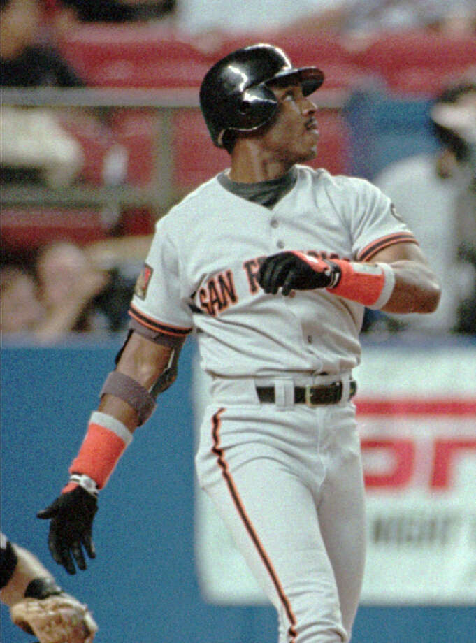 San Francisco Giants' Barry Bonds watches the ball go over the left center field fence after he hit a solo home run in the first inning, Sunday, Aug. 7, 1994, in Houston. Photo: Tim Johnson, Associated Press / AP