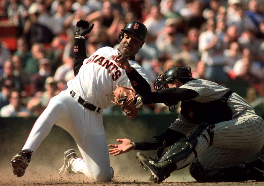San Francisco Giants' Barry Bonds, left, slides safely into home plate to score the Giants' fifth run as Pittsburgh Pirates catcher Jason Kendall applies a tag during the seventh inning of their game in San Francisco, Thursday Sept. 24, 1998. Photo: Eric Risberg, AP / AP