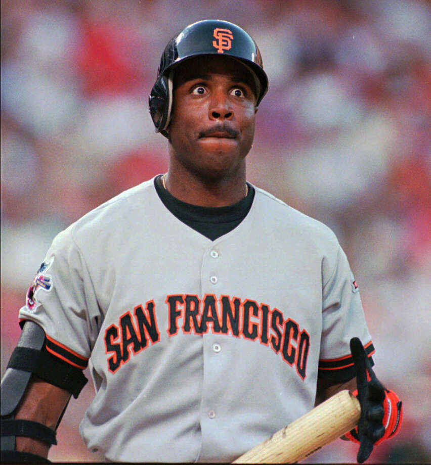 San Francisco Giants' Barry Bonds is wide-eyed after taking strike two from Texas Rangers pitcher Darren Oliver during the fourth inning of an interleague game Thursday night, June 12, 1997, in Arlington, Texas. San Francisco won 4-3. Photo: Tim Sharp, AP / AP