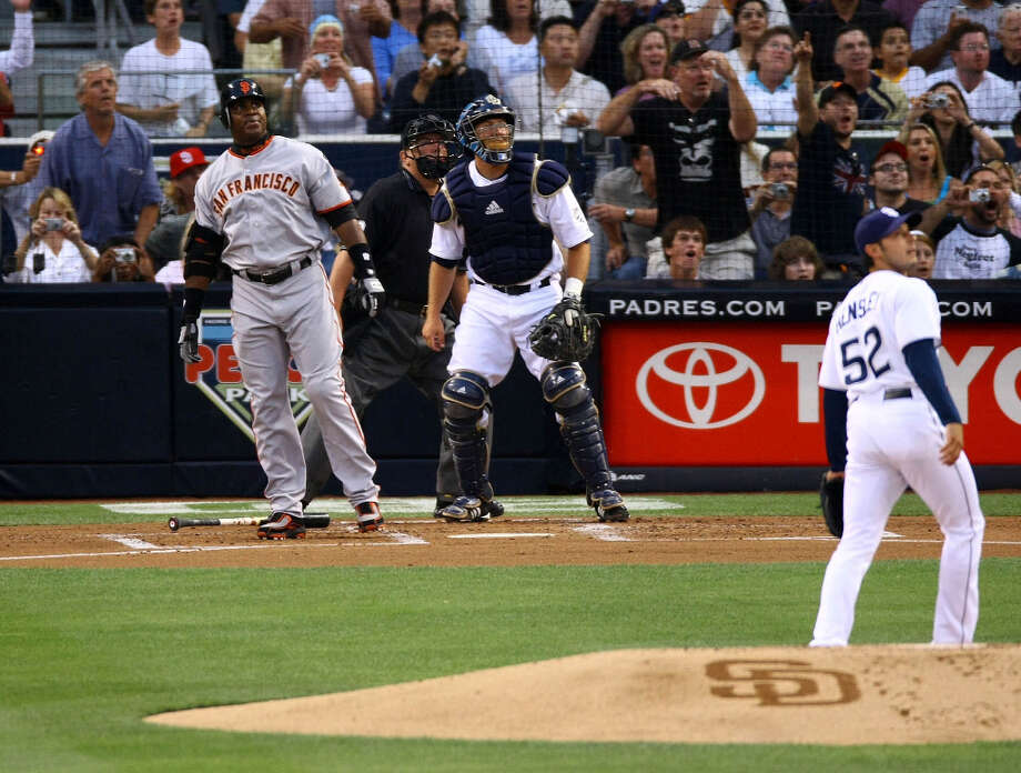 Barry Bonds of the San Francisco Giants watches the ball with Clay Hensley and Josh Bard after hitting his career home run number 755 in the second inning against the San Diego Padres during a MLB game at Petco Park August 4, 2007 in San Diego, California. Bonds tied Hank Aaron's career all time home run record. Photo: Stephen Dunn, Getty Images / ONLINE_YES