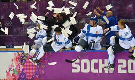 Finland celebrates as time runs out against the USA during the third period of the men's Bronze Medal hockey game at the Winter Olympics in Sochi, Russia, Saturday, February 22, 2014. Finland defeated USA 5-0 to capture the Bronze Medal. (Harry E. Walker/MCT)