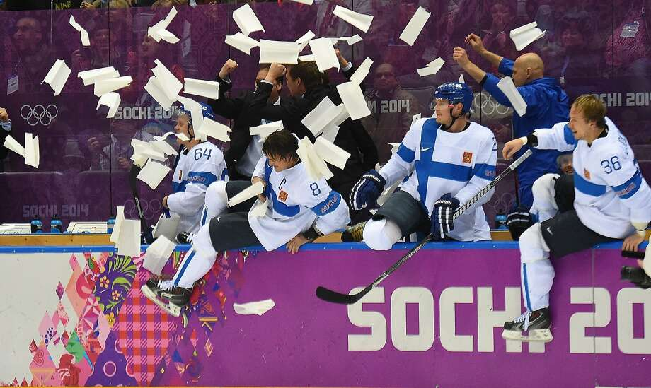 Finland's celebration begins as time runs out on American hopes of bringing home a medal. Photo: Harry E. Walker, McClatchy-Tribune News Service