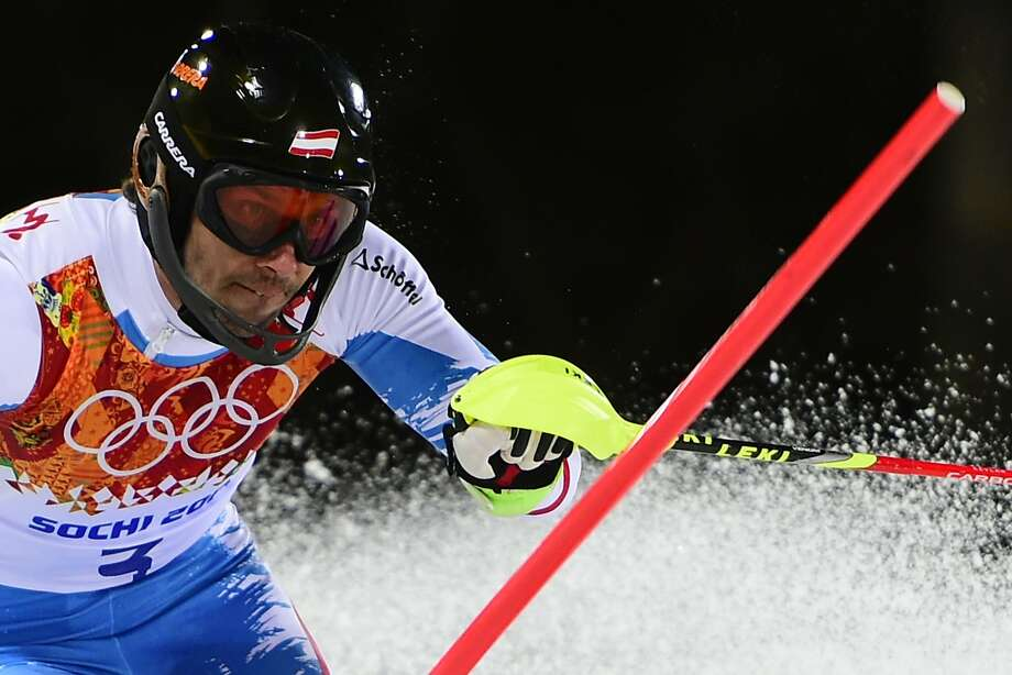 Mario Matt of Austria clears a gate on his way to becoming, at age 34, the oldest winner ever of an Olympic Alpine event. Photo: Fabrice Coffrini, AFP/Getty Images