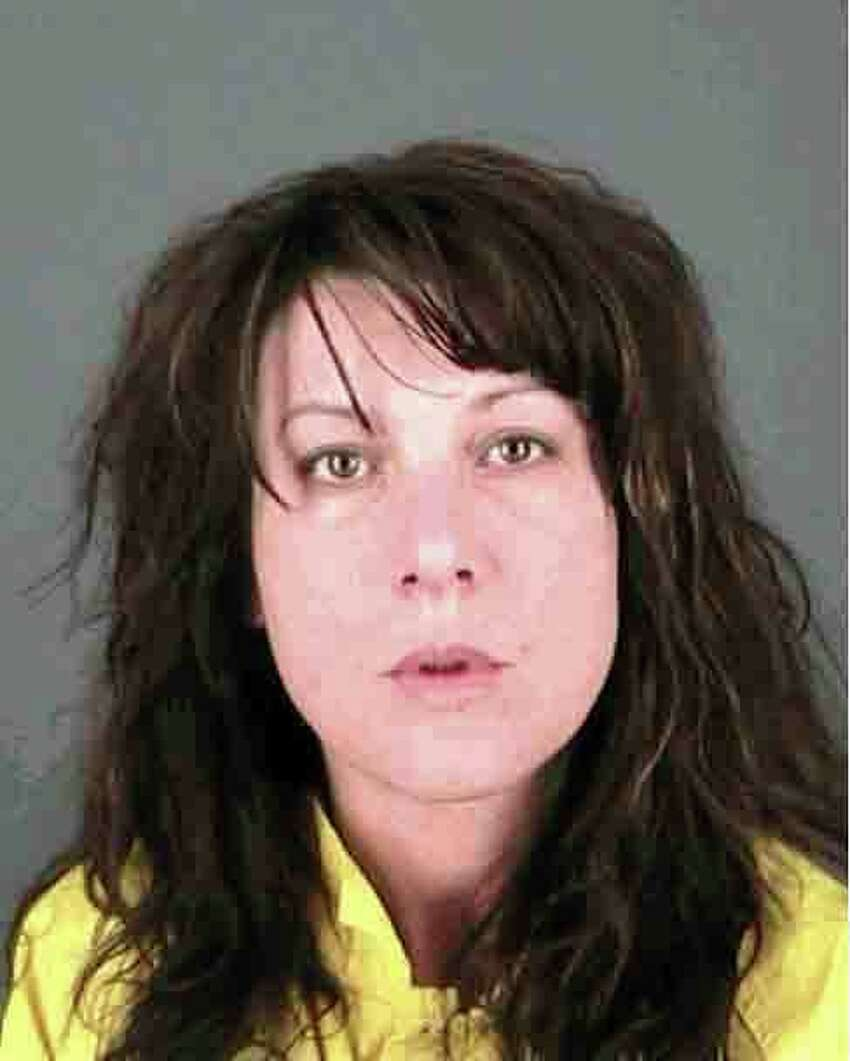 Sara D. Moore, 35, was charged with murder Friday, the day after police said they found a man dying inside his Albany home. (Albany Police Department) ORG XMIT: MER2014020709135843