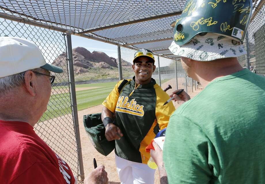 A's slugger Yoenis Céspedes talks with fans after practice at Papago Park. Photo: Michael Macor, The Chronicle