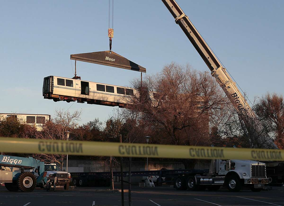 A Bart cart is lifted from the tracks near the Concord Bart station in Concord, Calif. on Saturday, Feb. 22, 2014. A train derailed near the Concord Bart Station late Friday night.