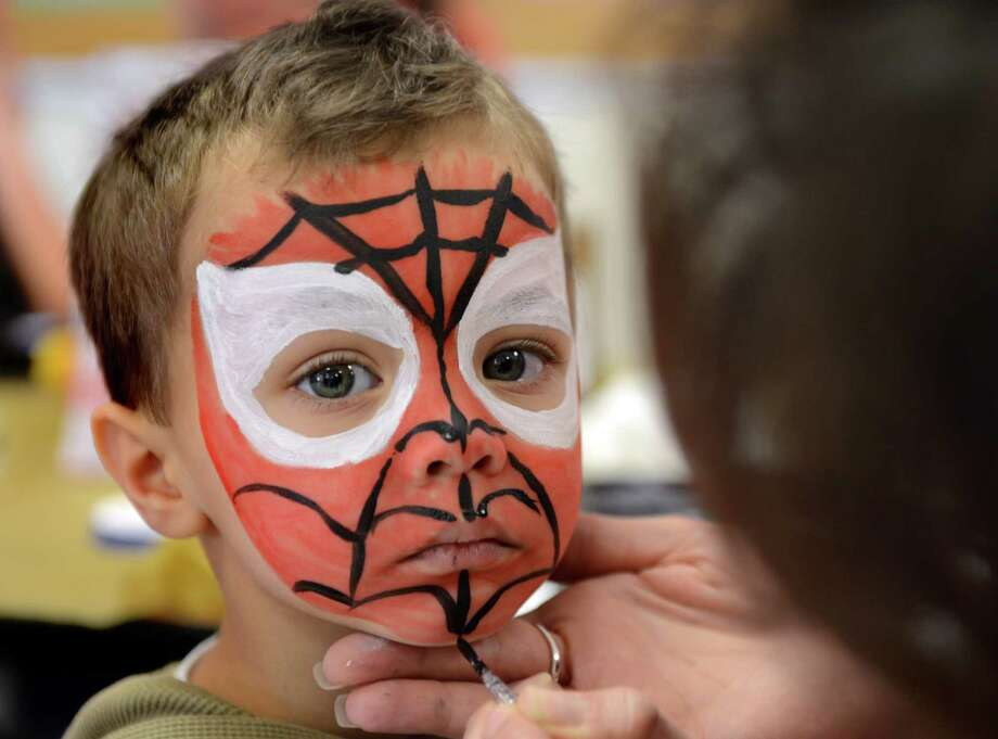 "Four-year-old Cameron Hirth, of Seymour, is transformed into Spider-Man Saturday, Feb. 22, 2014, during ""The Olympics"" Fun Fair in the gym at Bradley School in Derby, Conn. Photo: Autumn Driscoll / Connecticut Post"