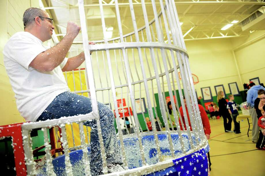 "Bradley School Principal Mario Ciccarini is in the dunk tank Saturday, Feb. 22, 2014, during ""The Olympics"" Fun Fair in the gym at Bradley School in Derby, Conn. Photo: Autumn Driscoll / Connecticut Post"