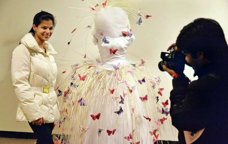 Richa Soni of Schenectady poses next to floral exhibit as her husband Sunil Soni, at right, takes her picture during the New York in Bloom annual fundraiser at the New York State Museum Saturday Feb. 22, 2014, in Albany, NY.  (John Carl D'Annibale / Times Union) Photo: John Carl D'Annibale / 00025848A