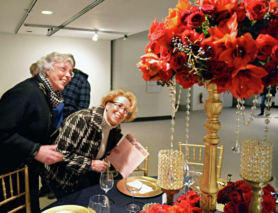 Pat Hartman, left, of Bethlehem and Pat Leary of Old Chatham take a close look at one of the floral exhibits during the New York in Bloom annual fundraiser at the New York State Museum Saturday Feb. 22, 2014, in Albany, NY.  (John Carl D'Annibale / Times Union) Photo: John Carl D'Annibale / 00025848A